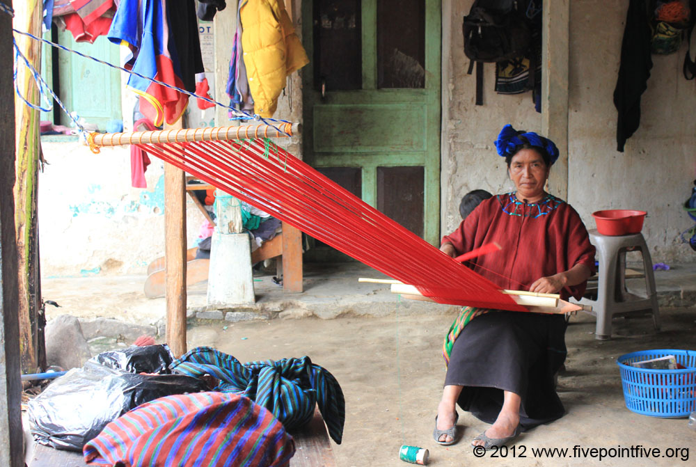 A woman weaves at home using skills she learned at the Cepac vocational centre